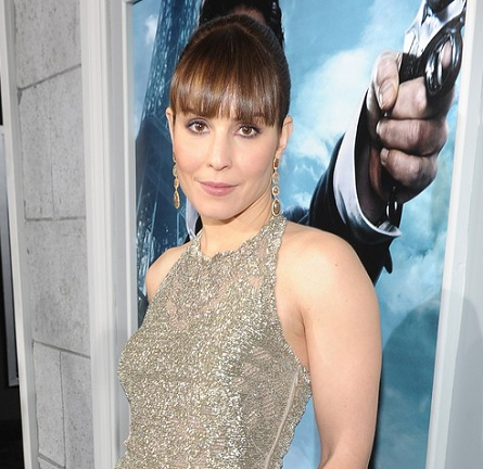 Noomi Rapace in Valentino | 'Sherlock Holmes: A Game Of Shadows' Premiere
