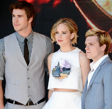 Liam Hemsworth in Dolce and Gabbana & Josh Hutcherson in Calvin Klein Collection | 'The Hunger Games: Mockingjay Part 1' Photocall - 2014 Cannes Film Festival